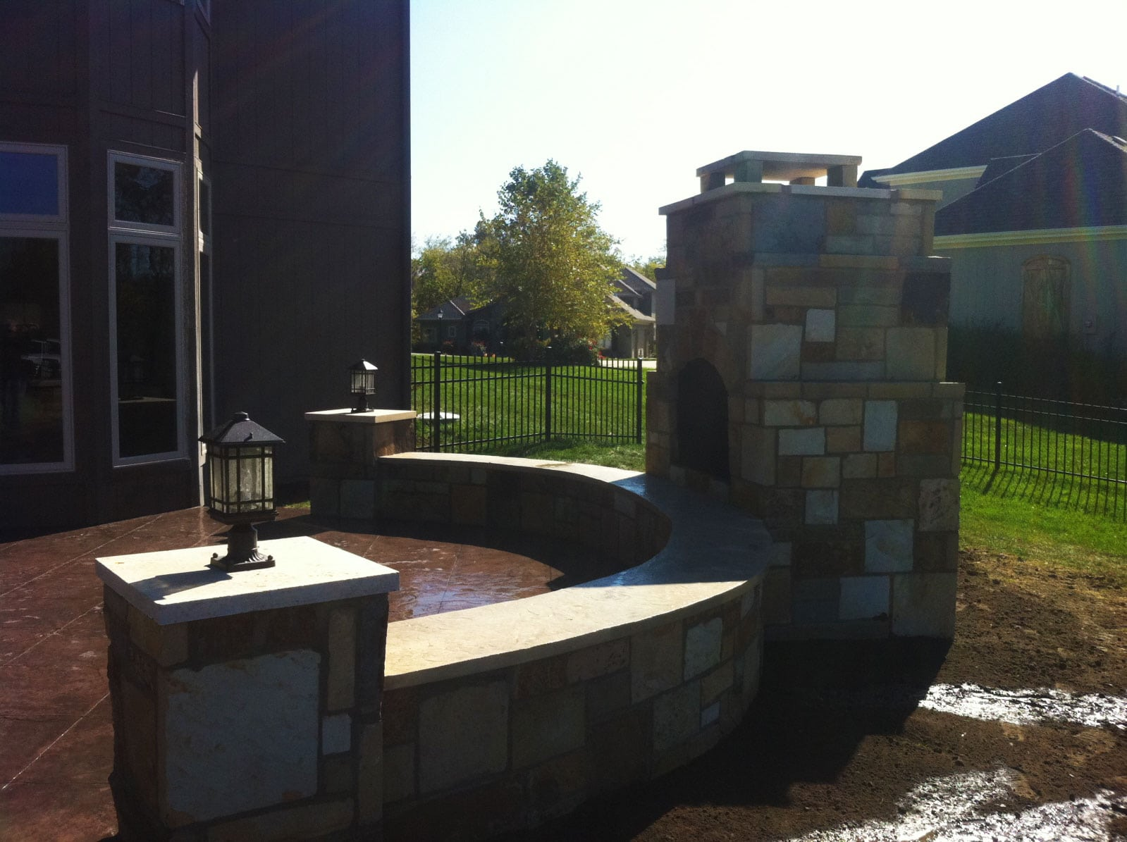 outdoor fireplace and wall